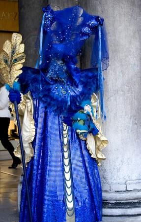 Woman in full decorative carnival costume in Venice.