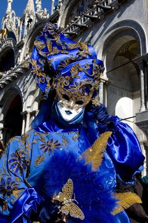 Woman in full decorative carnival costume in Venice.