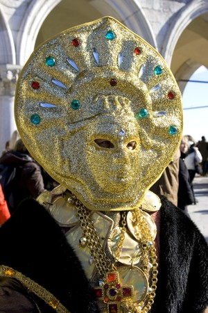 attired: Portrait of a man in a flamboyant costume at the carnival of Venice, Italy, 2009