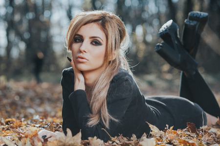Beautiful woman posing in the forest Stock Photo