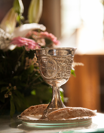 Silver chalice engraved prepared for the ritual in a church Stock Photo