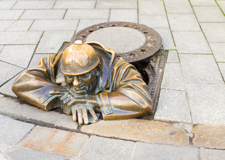 BRATISLAVA, SLOVAKIA - Cumil, the happy sewage worker statue. It was created in 1997 by artist Viktor Hulik and is one of most recognizable local landmarks.