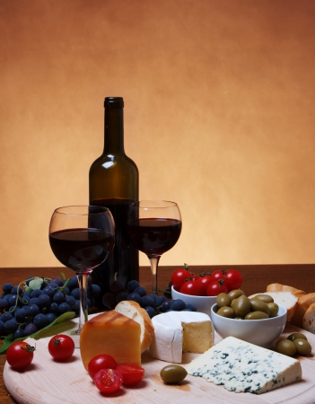 Still life with grapes, cheese and red wine photo