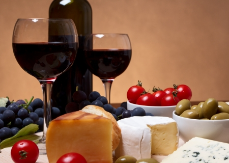 Still life with cherry tomato, red wine and cheese photo