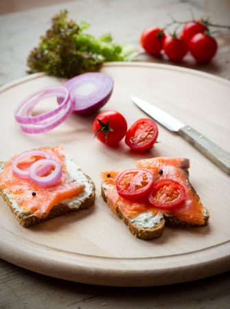 making a sandwich: Making a sandwich with smoked salmon Stock Photo