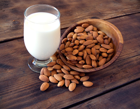 milk: Almond milk in glass with almonds