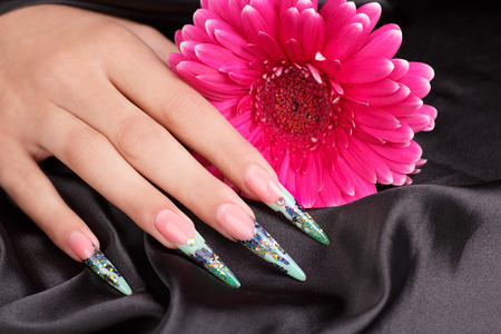 handcarves: Female hands displaying beautiful polished nails
