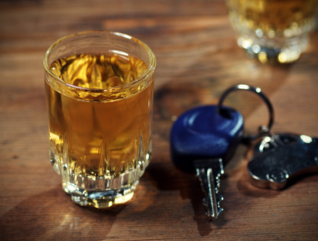 drunk driving: car keys  and a  whiskey shot