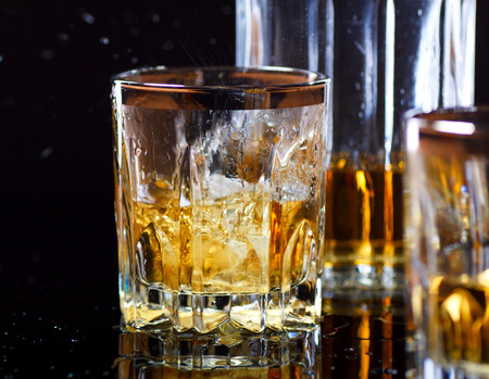 vertical image: Glass of Whiskey
