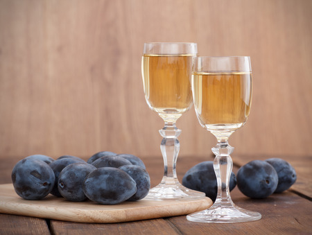Plum brandy or schnapps with fresh and tasty plum Imagens