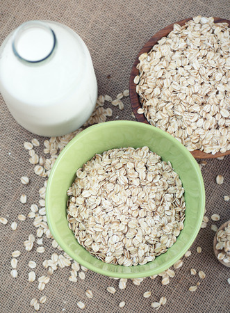 grits: Bowl of oatmeal and milk Stock Photo