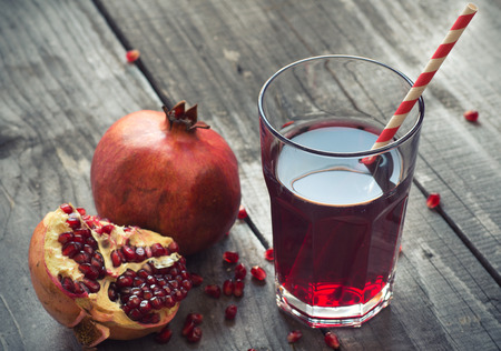 juice: glass of pomegranate juice with fresh fruits