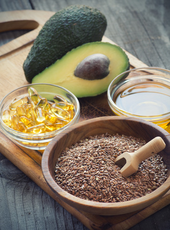 Sources of omega 3 fatty acids: flaxseeds, avocado, oil capsules and flaxseed oil Stok Fotoğraf - 39581102