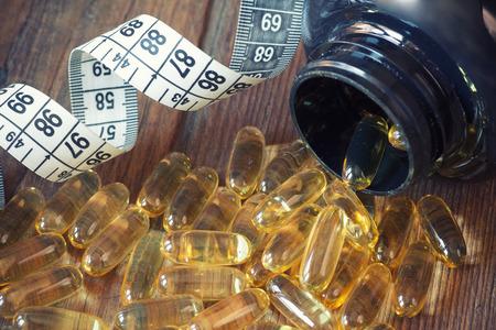 cod oil: Cod liver oil omega 3 gel capsules Stock Photo