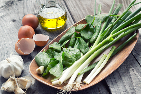 spinach salad: vegetable and eggs on table Stock Photo