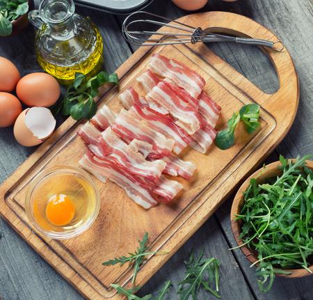 rukola: preparing breakfast - eggs and bacon Stock Photo