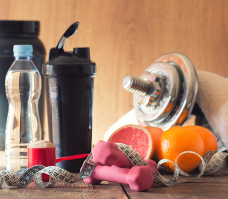 whey: The concept of weight loss - whey, dumbbells and fruit