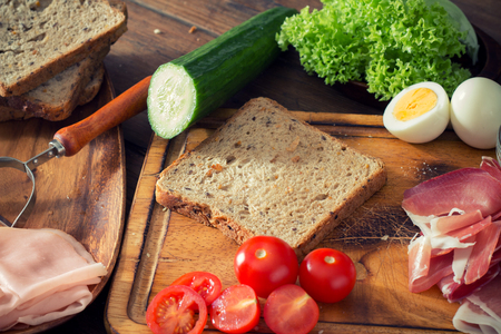 vegetarian food: preparing a sandwich in the kitchen Stock Photo