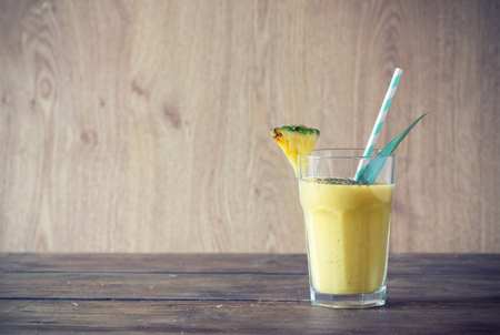 chia seed: pineapple smoothie with chia seed on wooden table. Stock Photo
