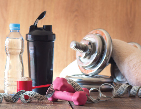 The concept of weight loss - whey and dumbbells
