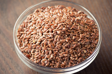 flax seeds in bowl on table background Stok Fotoğraf