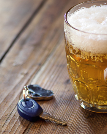 Concept driving and drinking: glass of beer and car key