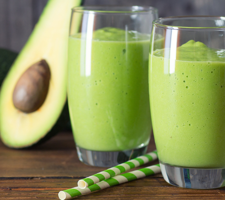 two fresh blended smoothies made with avocado