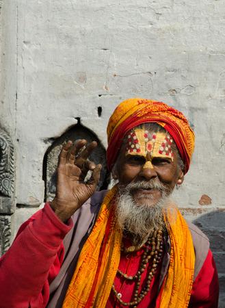 sadhu: Kathmandu, Nepal - February 19, 2014: unidentified Sadhu Holy men with traditional painted face, blessing in Pashupatinath Temple. February 19, 2014, Kathmandu, Nepal.