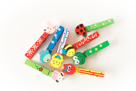colorful wooden clothespins close up  on white background