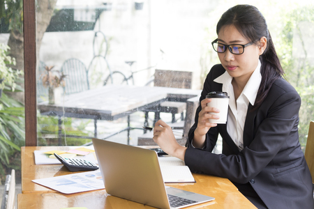 Bussiness concept, Bussiness woman working discussing the charts and graphs showing the results. Stock Photo