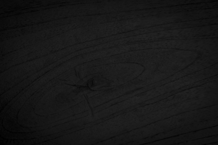 Wooden texture on black background.