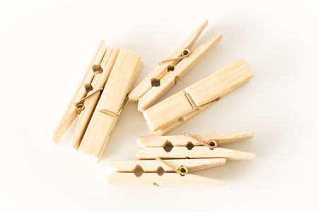 brown wooden clothespins isolated on white background
