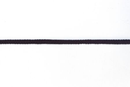 Black shoelaces on a white background