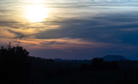 Sunset is the moment when the sun is hidden on the horizon in the west direction, being the beginning of the night. It can be considered as an inverse process of sunrise. Landscape in southern Brazil
