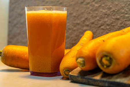 Carrot juice (Daucus carota). Plant of the apiaceae family. Source of beta carotenes. Tuberous root, orange, with a woody and edible texture. Ingredient for salads.