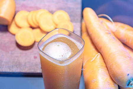 Detox juice. Carrot slimming juice (Daucus carota subsp. Sativus). Fresh and sliced carrots. Slimming drink. Natural drink with low calories. Stock Photo