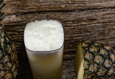 Pineapple juice and fruits (Ananas comosus). Fruit-symbol of tropical and subtropical regions, widely accepted throughout the world, both natural and industrialized