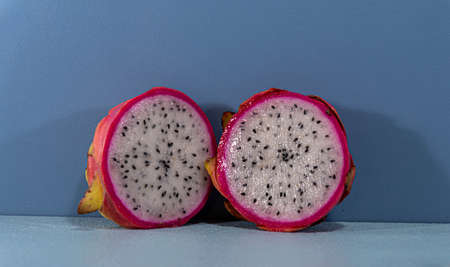 Pitaya fruits in halves. Pitaya is a fruit from countries like Mexico and other Central American nations. It is sweet, however, concentrates little sugar and helps those who want to lose weight.