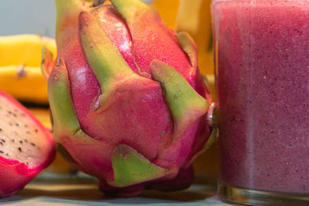 Pitaya juice and fresh fruits. Pitaya juice is rich in vitamins and is great for health. Detox and low calorie drink. Exotic and refreshing drink. Dragon fruit.