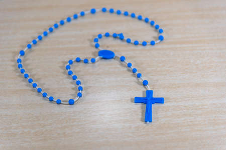 Rosary and religious crucifix. Symbols of Catholicism. Crucifix (Cross of Christ) is a symbol of veneration, which was initiated by Christians during the period after the crucifixion of Jesus Christ.