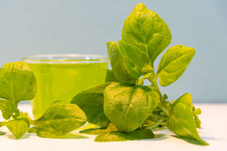 Green spinach juice (Spinacia oleracea). Natural drink. Vegan drink. Spinacia oleracea. Spinach is a vegetable that has a high nutritional value such as iron, calcium, phosphorus and vitamins A and B.