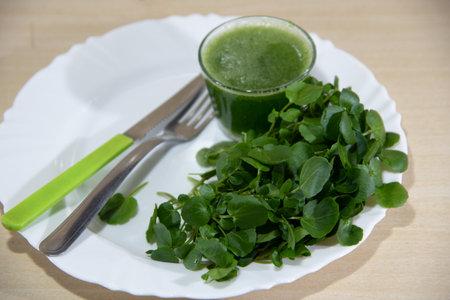 Watercress juice and salad (Nasturtium officinale). Detox drink and salad. Antioxidant greenery. Natural food. Energy drink. Green juice. Diet and balanced diet. Ingredient for salads.