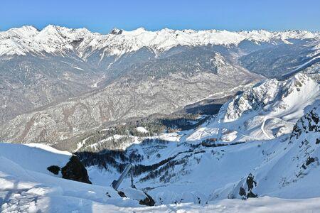 snow-capped mountain peaks in a ski resort Standard-Bild - 141756144