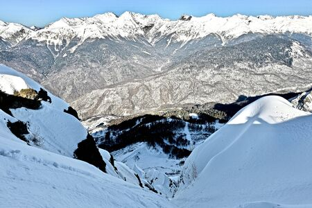 top view of a high mountain gorge with snowy ridges Standard-Bild - 141756576