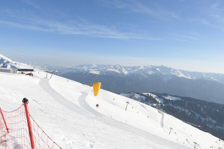 vacationers on the background of peaks in a ski resort Stock fotó