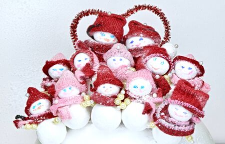 organized group of toy snowmen parents with children