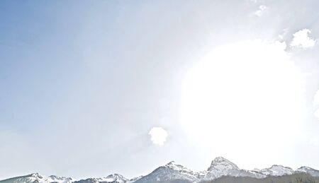 sunny blue sky and snowy mountain ranges on the horizon Standard-Bild - 149002239