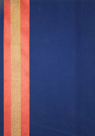 dark blue background for a card with red and yellow ribbons on one side