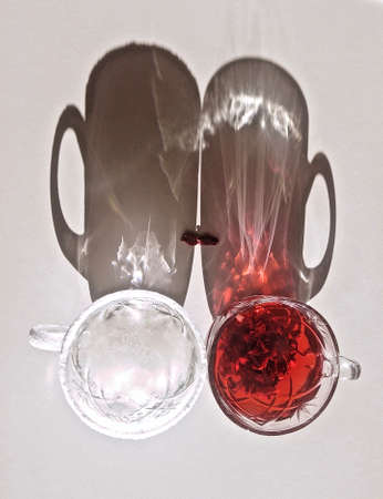 cups with hot and cold drinks with shadows