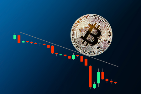 The fall of Golden bitcoin on blue black background Stok Fotoğraf